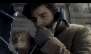 Inside Llewyn Davis- Llewyn with cat, making phone call