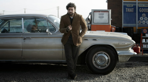 Inside Llewyn Davis- Oscar Isaac leaning on car