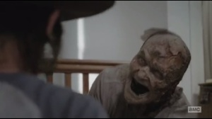 After- Carl finds one last walker inside an abandoned home