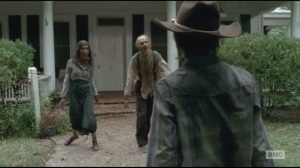 After- Carl finds two walkers at the door