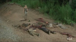 Inmates- Beth stands over the walker pile