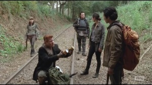 Us- Abraham offers Glenn supplies before he and Tara enter tunnel