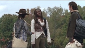Us- Michonne owes Carl some chocolate