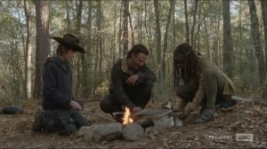 A- Carl, Rick and Michonne prepare food