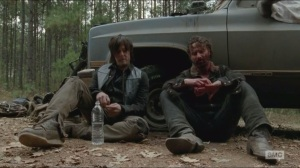 A- Daryl and Rick talk after marauders attack