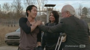 A- Hershel greets Glenn and Maggie as they arrive back at the prison