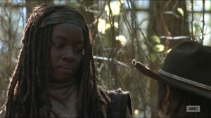 A- Michonne tells Carl how he, Andrea and the others brought her back