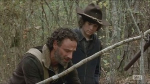 A- Rick teaches Carl how to set a noose