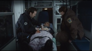 The Six Ungraspables- Deputy Solverson rides with Lester in the ambulance