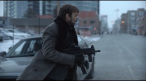 Who Shaves the Barber- Lorne Malvo walks past federal agents with machine gun