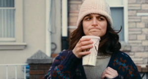 Obvious Child- Teary-eyed Donna stands outside Ryan's house