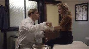 Kyrie Eleison- Dr. Langham works on Vivian's arm