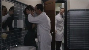 Parallax- Langham comes in the ladies' room just as Virginia knees Dr. Crane