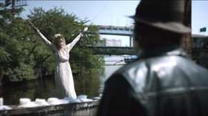 Spirit of the Goat- Bullock sees Amanda Hastings strung up on bridge