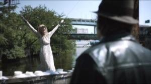 Spirit of the Goat- Bullock sees Amanda Hastings strung up on bridge