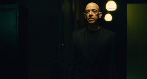 Whiplash- Terrence Fletcher, played by J.K. Simmons, watches Andrew play