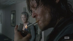 Consumed- Daryl lights up while Noah remains pinned under the bookshelf