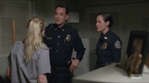 Crossed- Beth argues with the officers on what to do about Carol