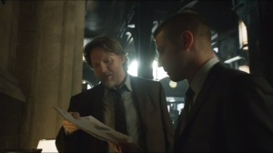 Harvey Dent- Bullock and Gordon look at rap sheet of Gregor Kasyanov, played by Steve Cirbus