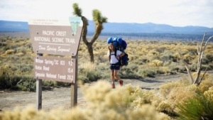 Wild- Cheryl coming up on Science Trail sign