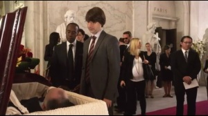 At the End of the Day, Reality Wins- At funeral, introduction to Ellis Gage Hightower, played by Demitri Martin