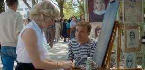 Big Eyes- Margaret meets Walter Keane, played by Christoph Waltz, at art gathering