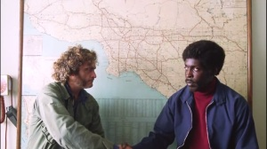 Inherent Vice- Doc meets with Tariq Kahlil, played by Michael Kenneth Williams, who tells him about Glen Charlock