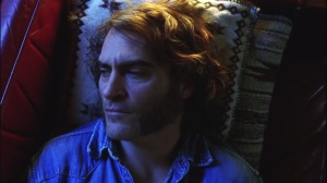 Inherent Vice- Larry 'Doc' Sportello, played by Joaquin Phoenix, sits in his beach home