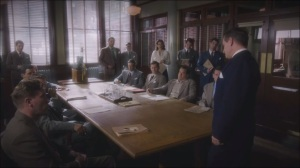 Now is Not the End- Chief Roger Dooley, played by Shea Whigham, briefs the team on Howard Stark