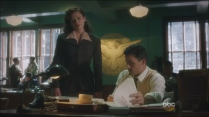 Now is Not the End- Peggy finds Daniel looking over some photos of Howard Stark