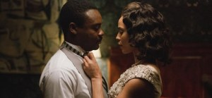 Selma- Coretta Scott King, played by Carmen Ejogo, helps her husband, Martin, played by David Oyelowo, with his tie