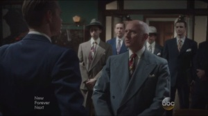 Valediction- United States Senator Walt Cooper, played by John Prosky, congratulates Thompson