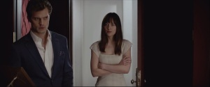 Fifty Shades of Grey- Christian shows Anastasia the red room