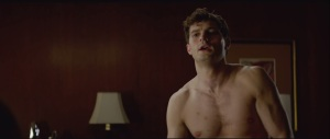 Fifty Shades of Grey- Christian takes off his shirt for some reason