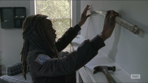 Forget- Michonne hangs up her sword