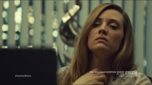 Certain Agony of the Battlefield- Delphine drinks while watching Shay and Cosima