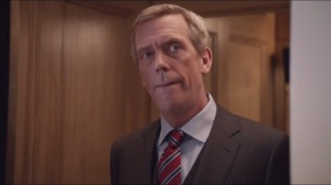 Convention- Enter Tom James, played by Hugh Laurie