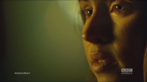 Scarred by Many Past Frustrations- Patty, played by Natalie Krill, reveals her bloodshot eyes to Art