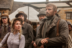 Far from the Madding Crowd- Gabriel and Fanny, played by Juno Temple, watch as soldiers recruit men