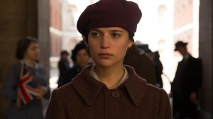 Testament of Youth- Vera Brittain, played by Alicia Vikander, walks through the crowd on Armistice Day