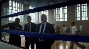 Strike Force- Gus Freeman, played by Danny Johnson, shows Barnes and Gordon around the gym