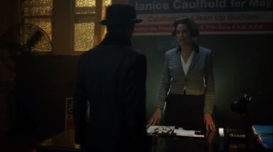Strike Force- Penguin confronts Janice Caulfield, played by Saundra Santiago