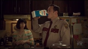 Waiting for Dutch- Lou drinks milk right from the carton while Betsy, played by Cristin Milioti, watches