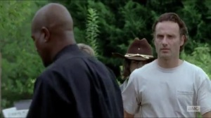 Heads Up- Rick about to rip down Gabriel's prayer circle fliers