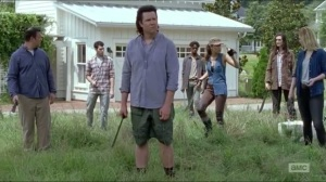 Heads Up- Rosita teaches Eugene and others how to use a machete