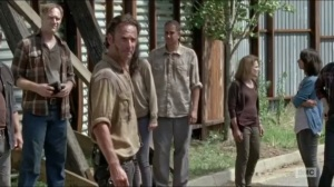 Now- Rick tells the townspeople that the walls will hold together to keep out the walkers