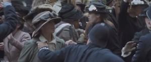 Suffragette- Officer about to strike suffragist
