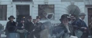 Suffragette- Throwing rocks through a store window