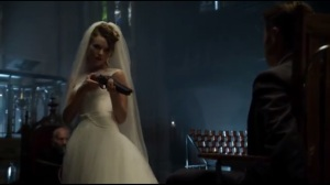 Tonight's the Night- Barbara in a wedding dress and holding a shotgun