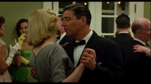 Carol- Carol and her husband, Harge, played by Kyle Chandler, dance at the party